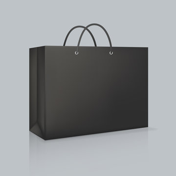 Mockup of realistic black paper bag. Corporate identity blank packaging.
