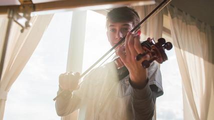 Boy practice violin