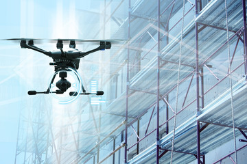 Drone on a background of a scaffolding. Wall mural
