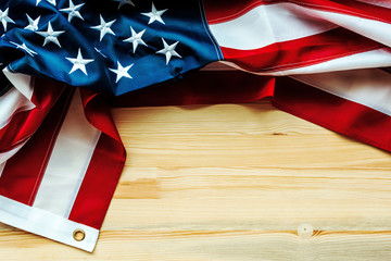 30f6e30ec030 USA flag crumpled on wooden background