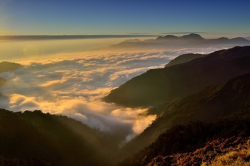 Sunset in mountains and sea of clouds