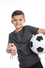 portrait of a young boy kid studio shot on white background with soccer football ball