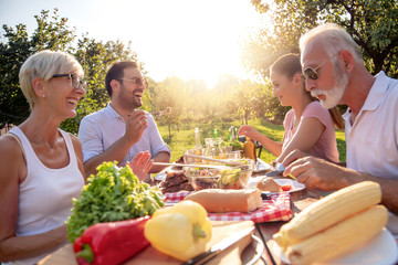 Family have lunch at summer party