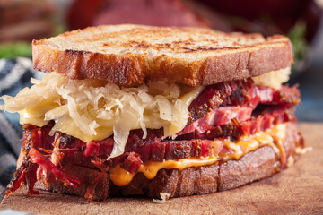 Spoed Fotobehang Snack Reuben Sandwich with corned beef, cheese and sauerkraut