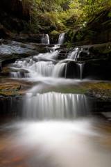 Aluminium Prints Mills Cascading water through gully into little rock pool