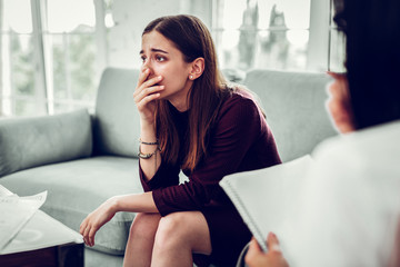 Client of therapist feeling shocked after realizing her problem
