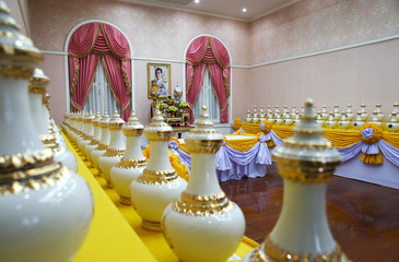 A picture of Thailand's King Maha Vajiralongkorn is seen among ewers containing sacred water for his upcoming coronation ceremony at the Interior Ministry in Bangkok
