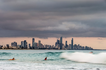 Surfers surfing at Gold Coast