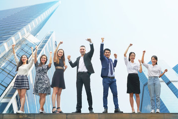 International teamwork cheer up with blue theme background business building. Wall mural