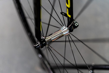 Road bicycle fornt wheel hub located . on fork with spokes and rim