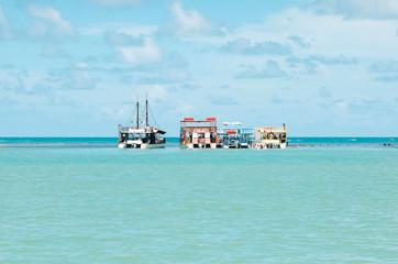 Three Catamaran boats in the middle of sea. Touristic Catamarans taking tourists to swim in Picaozinho corals, at Joao Pessoa PB Brazil.
