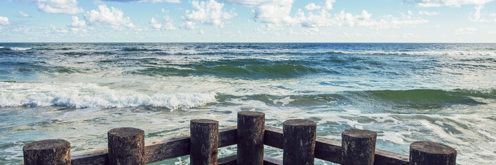 Fototapete - horizontal line of sea waves and wooden balls panorama