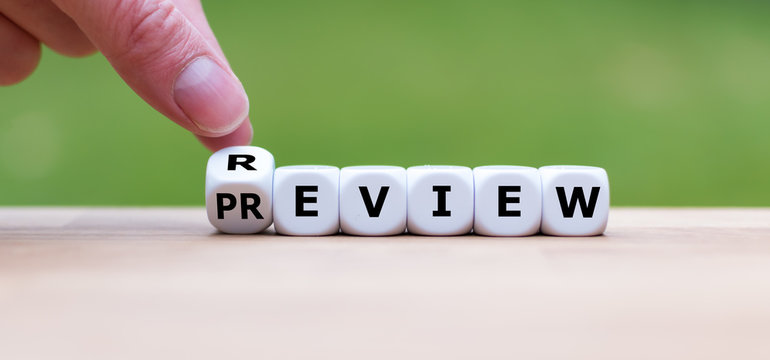 """Hand turns a dice and changes the word """"PREVIEW"""" to """"REVIEW"""" (or vice versa)."""