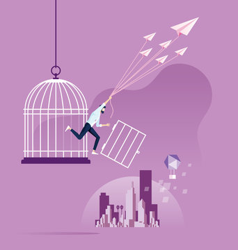 Freedom concept. Businessman escape from birdcage by paper plane