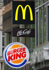 Logos of fast food chains McDonald's and Burger King are seen in front of their restaurants in Paris
