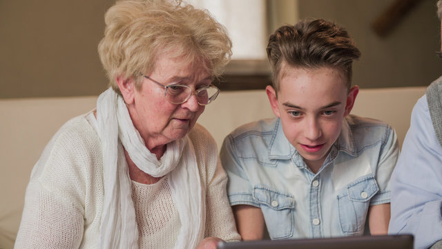 Short sighted grandmother cant see the grandchild laptop