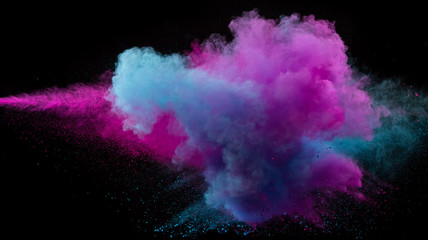 Collision of two colored powders isolated on black