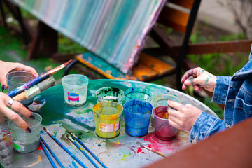 outdoors kinder garden children draw with paints