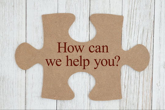 How can we help you text on a cardboard puzzle piece