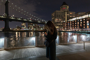 Women on the smartphone in New York at night