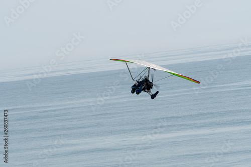 An ultralight trike in flight over the Florida coast