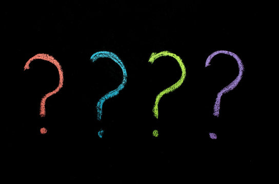 colored question marks on chalkboard