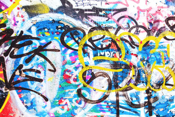 Closeup of texture damaged colorful graffiti wall