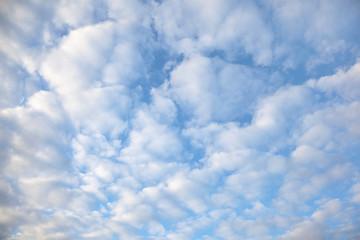 Clouds in a bright  blue sky.