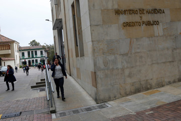 People walk near Colombian Ministry of Finance and Public Credit in Bogota