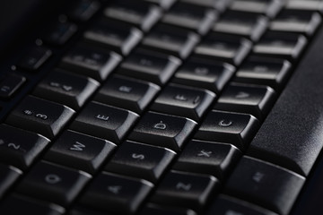 Fototapete - Close-up of a black keyboard