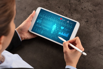 Business woman making healthy analysis on tablet