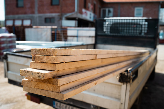 Building material planks in the truck ready to delivery to the construction site