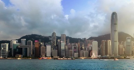 Fototapete - Hong Kong skyline in the evening over Victoria Harbour