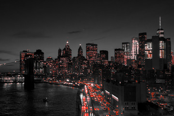 New York City black and white night skyline with red lights glowing in downtown Manhattan