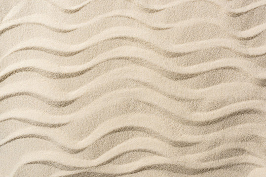 top view of textured background with sand and smooth waves
