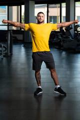 Handsome Man Posing In Yellow T-shirt