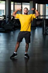 Muscular Man Posing In Yellow T-shirt