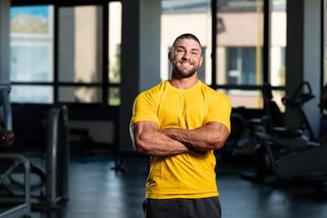 Healthy Man Posing In Yellow T-shirt