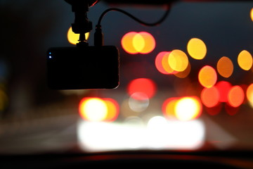 Fotomurales - video camera recorder in car driving on night urban road