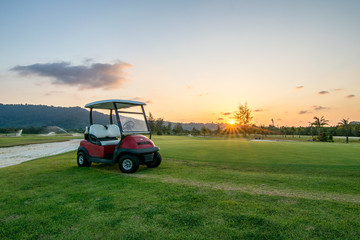 The golf course landscape with beautiful sky. Golf cart at the green golf course