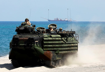 U.S. Marines ride an amphibious assault vehicle during the amphibious landing exercises of the U.S.-Philippines war games promoting bilateral ties at a military camp in Zambales province