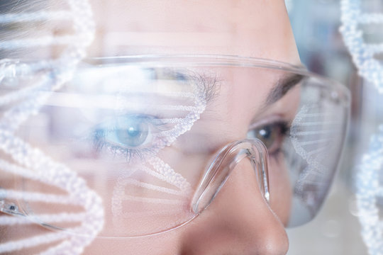 A female face in virtual reality glasses with dna image model reflection on them.