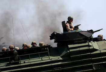 U.S. Marines arrive in an amphibious assault vehicle during the amphibious landing exercises of the U.S.-Philippines war games promoting bilateral ties at a military camp in Zambales province