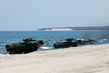 Amphibious assault vehicles arrive during the amphibious landing exercises of the U.S.-Philippines war games promoting bilateral ties at a military camp in Zambales province