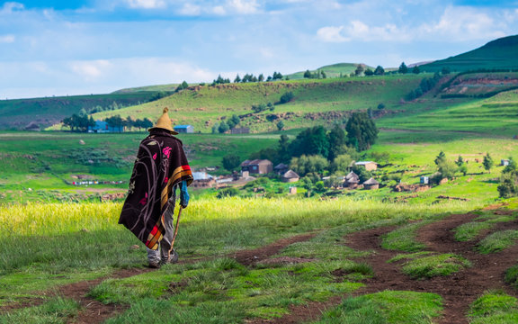 Basotho man with basotho blanket and basotho hat walking in the mountains in Semonkong, Lesotho, Southern Africa
