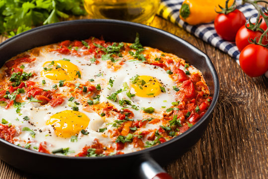 Shakshouka, dish of eggs poached in a sauce of tomatoes, chili peppers, onions