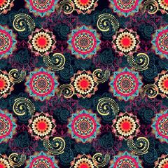 Bright pattern in indian style. Seamless ornament on dark.