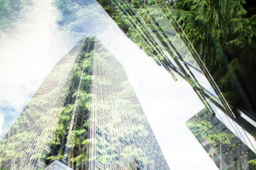 Fototapete - green city - double exposure of lush green forest and modern skyscrapers windows