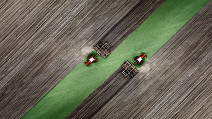 Aerial top view of a tractor, combine harvester plowing agricultural land in the spring