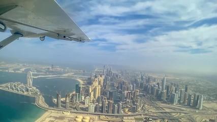 Wall Mural - Aerial view of Dubai from plane, Dubai Marina skyline and Dubai eye - Video HD